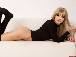 Taylor Swift Pantiless On a Sofa